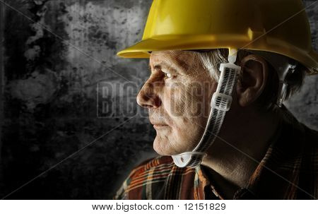 a senior worker with an hardhat