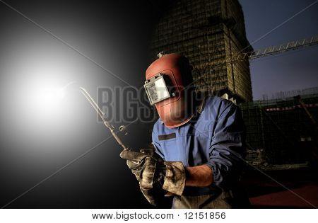 Portrait of factory welder on a cityscape background