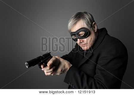 a robber pointing a gun