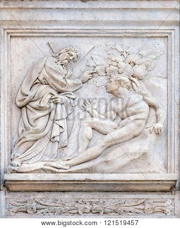 BOLOGNA, ITALY - JUNE 04: Creation of Adam, Genesis relief on portal of Saint Petronius Basilica in Bologna, Italy, on June 04, 2015