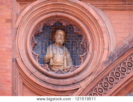 BOLOGNA, ITALY - JUNE 04: Saint Peter, Medieval palace of the merchandise or loggia of the merchants in Bologna, Italy, on June 04, 2015.
