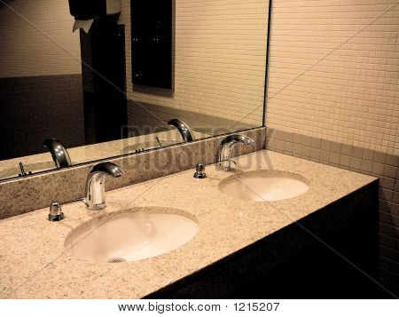 Public Restroom With Sinks And Mirror