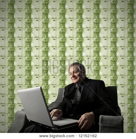 Senior businessman earning money with a work on line
