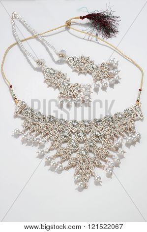 Modern Intricate Indian Jewelry Diamond Necklace Set On White Background