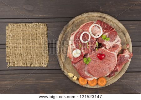 Raw beef shin and vegetables. Sales of beef. Preparing meat for cooking