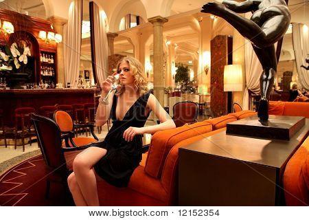 Beautiful girl in a luxury bar