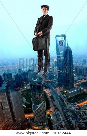 Business man flying over a city