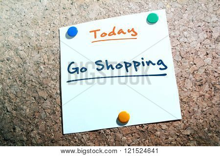 Go Shopping Reminder For Today On Paper Pinned On Cork Board