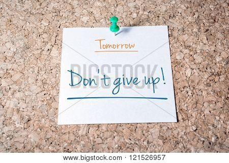Don't Give Up Reminder For Tomorrow On Paper Pinned On Cork Board