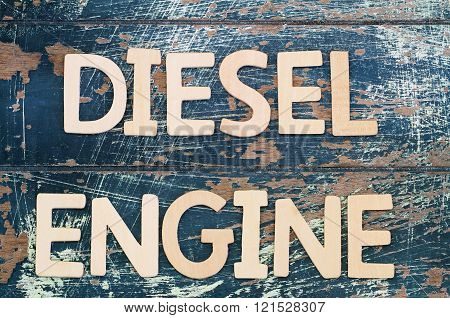 Diesel engine written with wooden letters on rustic surface