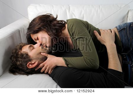 intimate young couple on a sofa