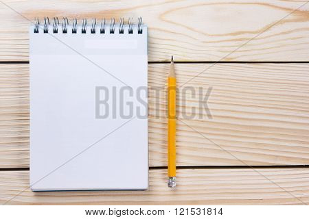 Back to school. Blank note pad, notebook with pen and glasses