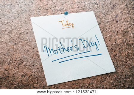 Mother's Day Reminder For Today On Paper Pinned On Cork Board