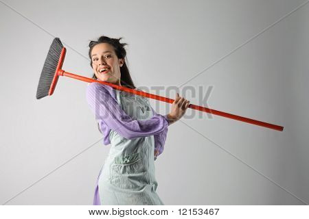 portrait of a beautiful housewife with broom