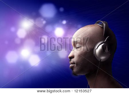 attractive black guy listening music with earphones
