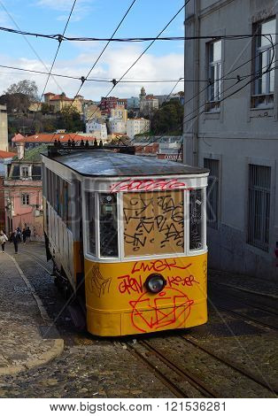 Elevador da Gloria vintage funicular railway with graffiti.