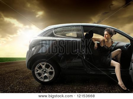 beautiful girl sitting in a sport car