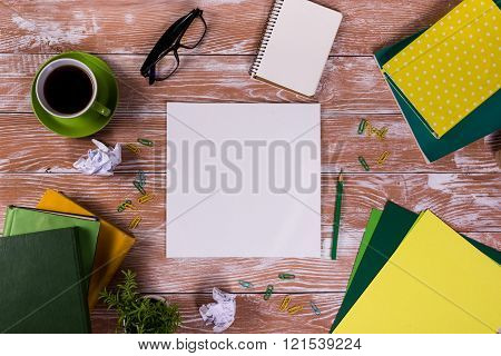Office table with notepad, books and coffee cup. Business creative consept.
