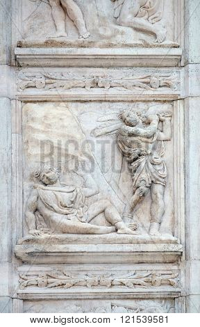 BOLOGNA, ITALY - JUNE 04: The Abel killing, Genesis relief on portal of Saint Petronius Basilica in Bologna, Italy, on June 04, 2015