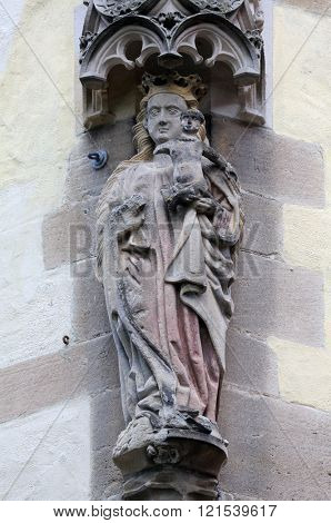 TUBINGEN, GERMANY - OCTOBER 21: Virgin Mary with baby Jesus, Collegiate Church of St. George in Tubingen, Germany on October 21, 2014.
