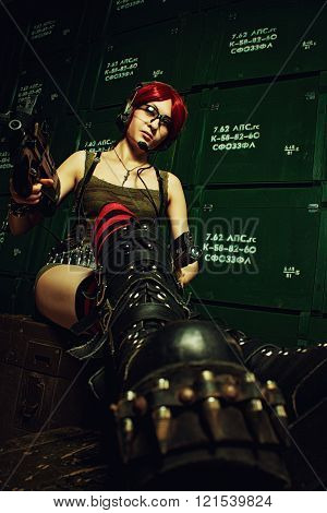 Redhead girl posing with weapons in a storage