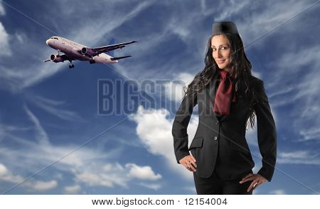cute air hostess with airplane flying on the background