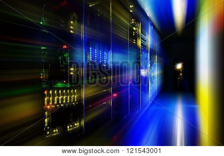 server room in dark, with bright colored lights motion