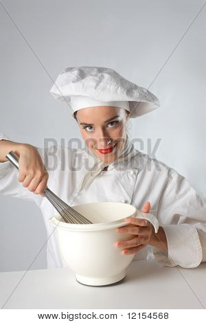 female cook whisking