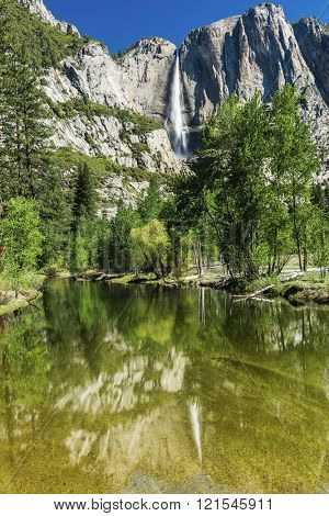 Yosemite Falls reflecting in Merced River. Yosemite National Park - California, USA