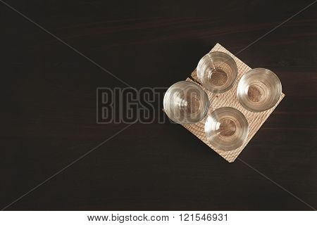 Set Of Transparent Cups Isolated On Wooden Table Top View