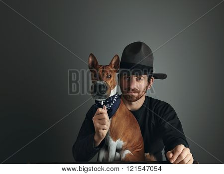 Adventurer Looks On Camera With His Dog Through Magnifyer