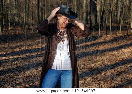 Cowgirl adjusts Hat