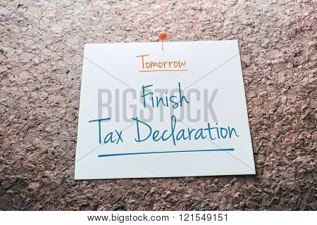 Finish Tax Declaration Reminder For Tomorrow On Paper Pinned On Cork Board