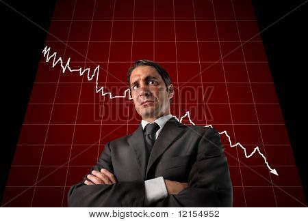 business man with crisis graphic behind