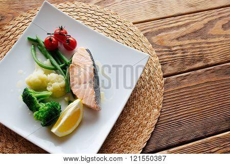 Dietary food. Salmon steak with vegetables.