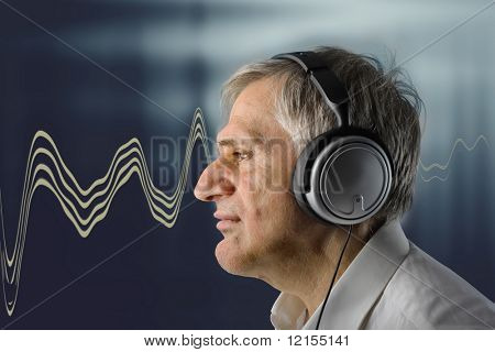 mature man listening music