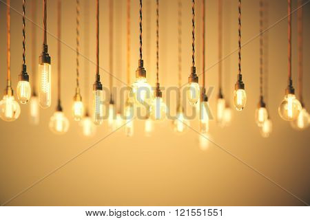 Bulbs With Long Filaments On Orange Background