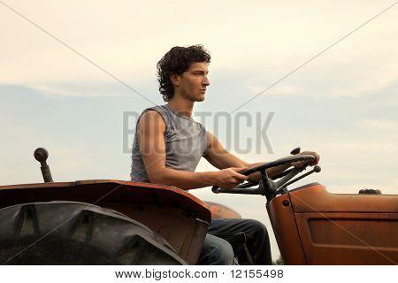 portrait of farmer driving tractor
