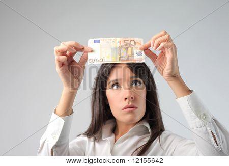 Woman controlling a euro banknote