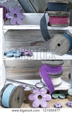 Colorful Wooden Reels With Linen Ribbons On Wooden Background