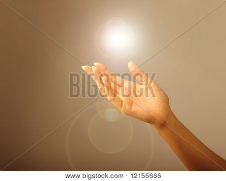 woman hand and a rising light