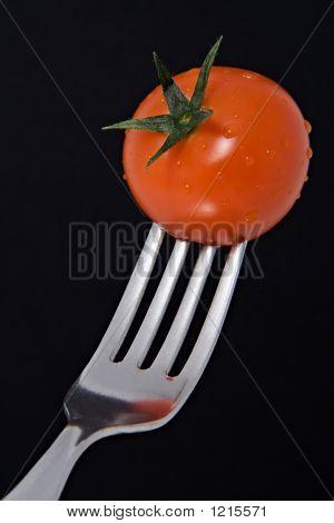 Fresh Cherry Tomato On A Fork