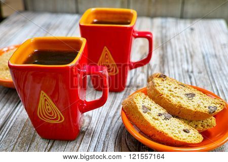 Dessert two cups with espresso coffee and amandel cantuccini on rustic wooden backgound