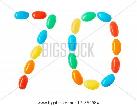 70 Number Made Of Multicolored Candies Isolated On White