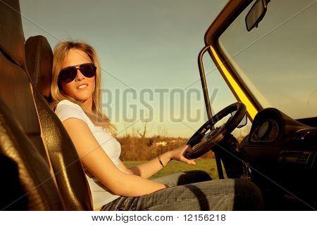 pretty female teen driving a car