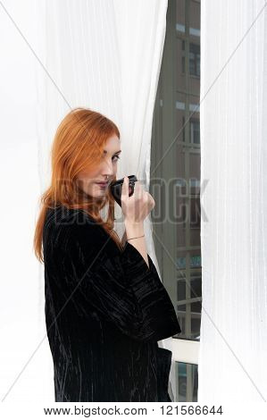 Young Redhead Woman With Black Coffee Mug