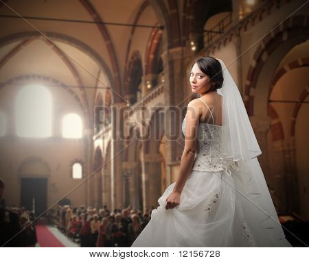 rear view of bride waiting in a crowded church