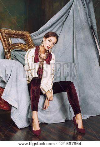 beauty rich brunette woman in luxury interior near empty frames, vintage elegance hispanic, home alo