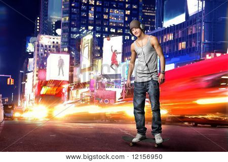 guy with headphones in Time Square