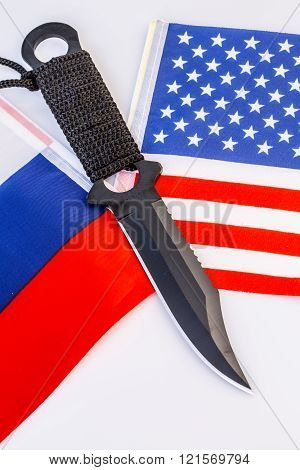 Usa And Russia Flags With Knife - Conflict